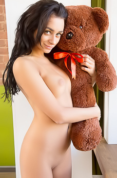 Inga toying with bear