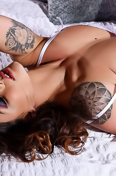 Tattooed pornstar Mica Martinez