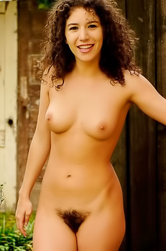 Curly brunette with hairy pussy