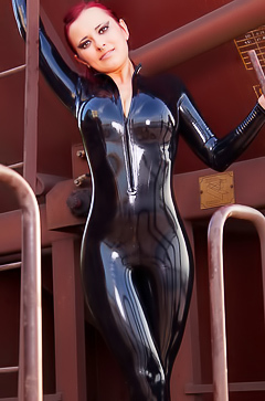 Lara Larsen in sexy black latex suit