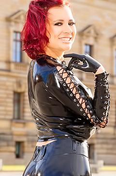 Lara Larsen - redhead babe in latex