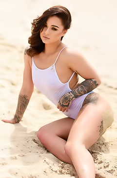 Mica Martinez relaxing On Beach