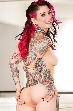Joanna Angel strips off pink dress