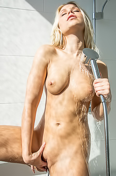Lara is masturbating after a shower