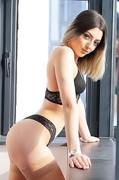 Nude Aubrey Nova is posing by the window