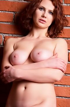 Busty milf Aphrodita is showing her body