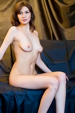 Hot brunette is posing naked