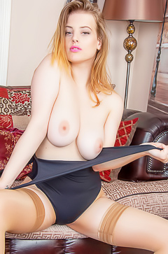 Hot girl Lottie Rose spreading legs in stockings