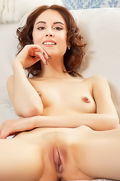 Lovely Sabrina is relaxing naked