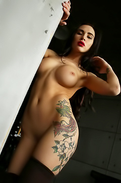 Glamour brunette Kira with tattoos