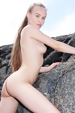 Naked Angel on the rocks