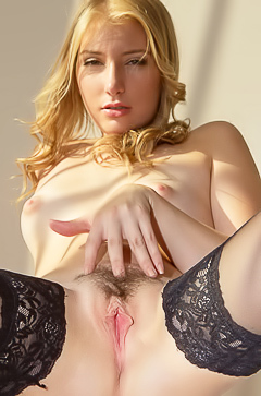 Horny blonde is masturbating on the table