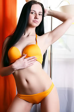 Veronica Snezna in orange lingerie