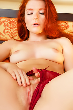 Redhead Mia Sollis in red lingerie