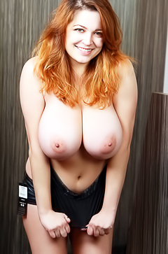Redhead Tessa Fowler with big boobs