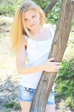 Teen Posing Between Trees