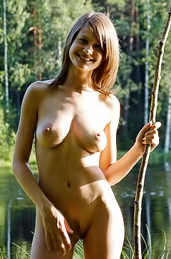 Lea posing nude by the lake